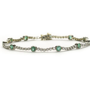 Emerald and diamond line bracelet in 18ct gold