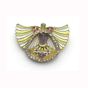 Carved Amethyst & Enamel Head Brooch