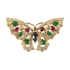 Contemporary diamond emerald ruby and sapphire butterfly brooch in 18ct gold