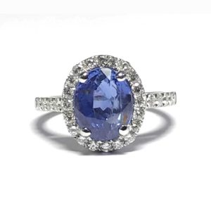 Sapphire engagement ring, with diamond surround cluster halo white gold