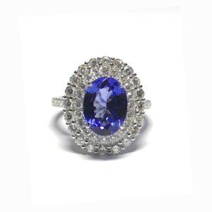 Tanzanite and diamond halo cluster ring