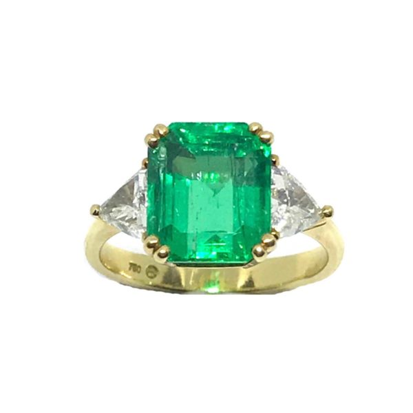 Colombian Emerald and diamond three stone ring