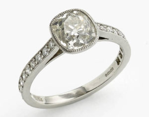 Cushion cut diamond engagement ring old cut platinum bezel rub over setting