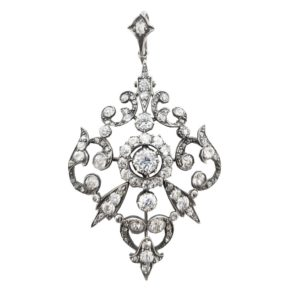 Antique Diamond Pendant/Brooch, open scrollwork and fleur-de-lis design, set in silver and gold