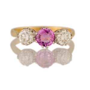 Antique Pink Sapphire and Old-Cut Diamond Trilogy Ring, 0.60 carats, 18ct yellow gold