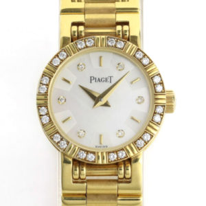 Piaget Diamond Dancer Watch in 18K Yellow Gold. Mother of pearl dial with diamond hour markers. and diamond set bezel. With Box. Quartz