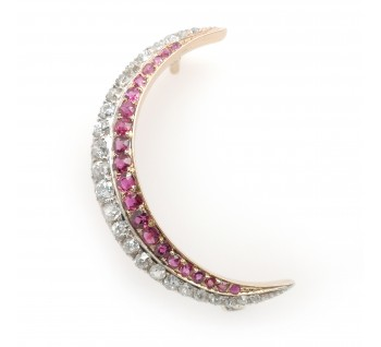 C.1890 Ruby and Diamond crescent brooch, set in silver and gold, with pierced gallery
