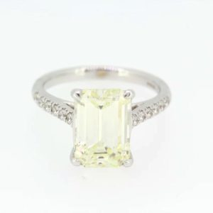 Exquisite Emerald cut solitaire diamond weighing 4.14 carats set with round brilliant cut diamond shoulders totaling 0.24 carats, 18ct white gold.