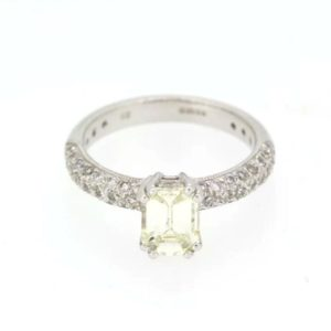 Emerald Cut Diamond Ring; Central emerald cut 1.00 carat diamond, with pave set shoulders totaling 0.55 carats, Hallmarked 18ct white gold