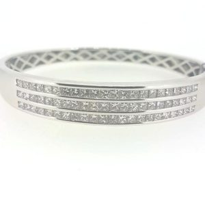 Princess Cut Diamond Bangle; Triple row of  princess cut diamonds channel set into solid 18ct white gold hinged bangle. Diamond total weight: 4.80 carats