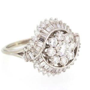 Vintage Diamond Cocktail Ring, c.1960's; set with round brilliant and baguette cut diamonds. Central floral cluster with double crossover. Est 3.50 ct total