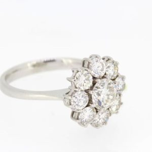 Diamond Floral Cluster Ring; Round brilliant cut diamonds arranged in a daisy flower cluster. Total estimated diamond weight is 1.80 carats