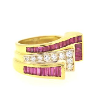 French Vintage Ruby and Diamond Ring, Central row of round cut diamonds flanked by baguette cut rubies. Circa 1940. French hallmark, 18ct yellow gold.