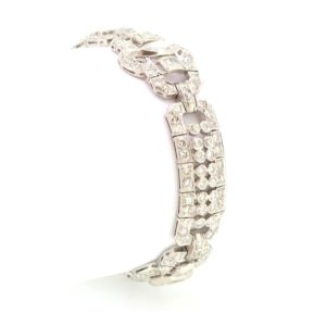 A Luxurious Art Deco diamond bracelet, a statement piece exhibiting the decadence of the era, circa 1930. Est. diamond weight totaling 12ct, Set in Platinum
