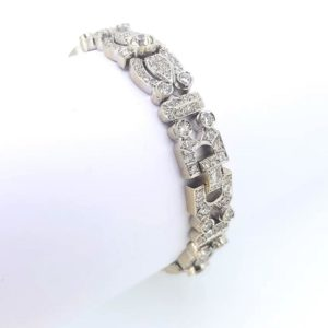 A stunning and intricate vintage diamond set bracelet emulating a hint of the Art Deco style. Diamond total weight is an estimated 12 carats. Bracelet weight: 42g