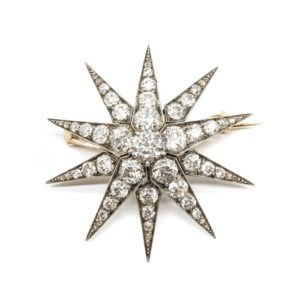 FRENCH ANTIQUE DIAMOND SILVER AND GOLD STAR BROOCH