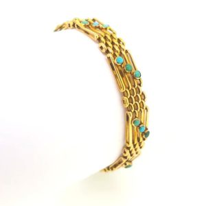 alternating gate bar and cluster links, each gate link set with a trio of cabochon turquoises,15ct yellow gold