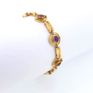 Vintage Amethyst Bracelet: Cabochon amethysts set into a double circular design, interspersed by gate links. A delicate statement piece.