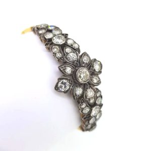 Vintage Old-Cut Diamond Bracelet; displaying a delicate floral pattern, set into silver and gold, backed onto an 18ct yellow gold sectional linked bracelet