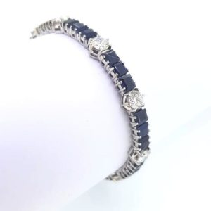 Vintage Sapphire and Diamond Bracelet; set with square cut sapphires and brilliant cut diamonds, 18ct white gold (Est. diamond total 5ct, sapphires, 10ct)