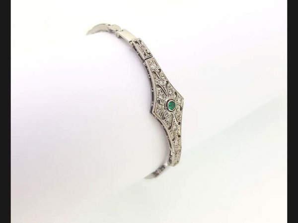 Vintage Emerald and Diamond Bracelet reminiscent of the Art Deco style; Diamond bracelet with central round cut emerald, on an expandable strap