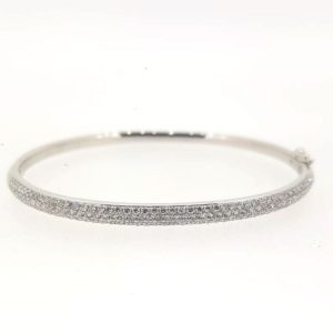 Diamond Bangle; Round cut diamonds pave set into an 18ct white gold bangle. Diamond total weight: 1.50 carats. Also available in 18ct yellow or rose gold