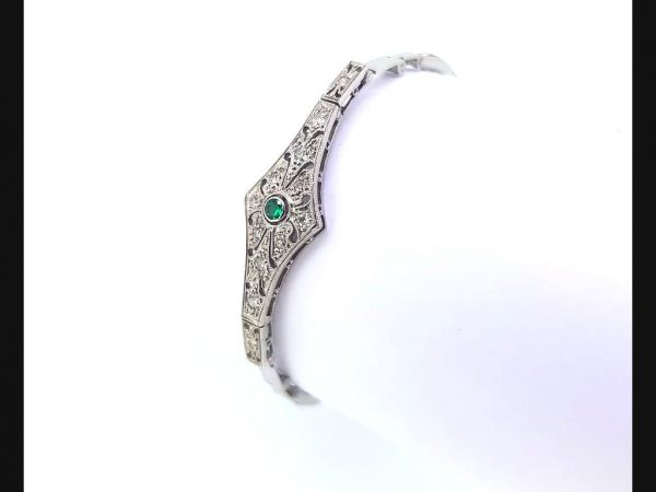 Vintage Emerald and Diamond Bracelet, on an expandable strap. Radiating the style of the Art Deco period