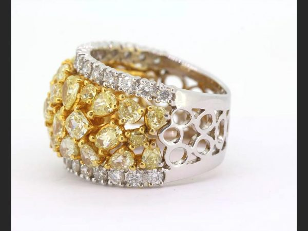 Yellow and White Diamond Bombe Ring; Central band of fancy yellow diamonds, est. total 3.50 ct