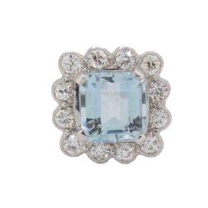 Aquamarine and diamond cluster ring step rectangular cut shape
