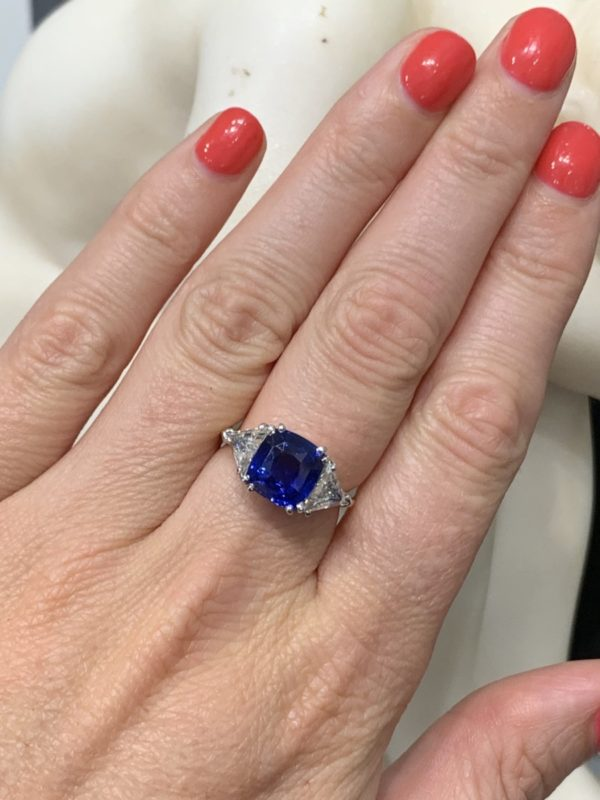 Sapphire engagement ring 4 carats cushion no heat triangular cut diamond shoulders