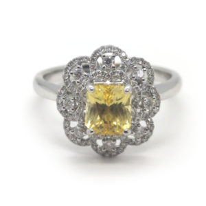 natural yellow sapphire no heat 1.50 carats rectangular cut cluster with round brilliant cut diamonds in a floral motif.