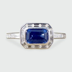 Emerald Cut Sapphire and Diamond Cluster Ring in Platinum