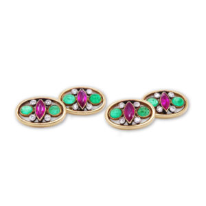 Antique Edwardian Diamond Ruby and Emerald set Cufflinks, each set withone marquise cut ruby, two cabochon emeralds and four old cut diamonds, 18ct yellow gold, gold chain fastenings, Circa 1910.