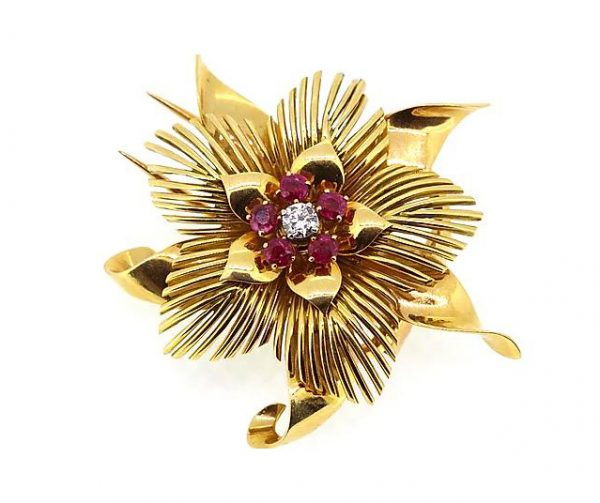 Vintage French Ruby and Diamond set 18ct Yellow Gold Floral Brooch; 18ct gold flower brooch set with one brilliant-cut diamond and five round-cut rubies.