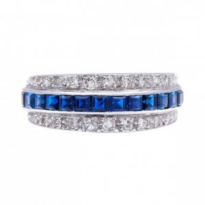 Vintage Sapphire, Diamond and Platinum Band Ring, 1.48cts, row of modified square cut sapphires flanked by single cut diamonds, elegant half eternity ring