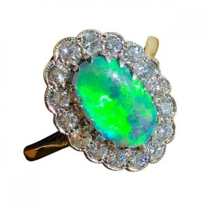 Antique Edwardian Black Opal and Diamond Oval Cluster Ring, in Platinum