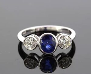 Oval Sapphire and Diamond Trilogy Ring, 1.82 carat total, 18ct White Gold