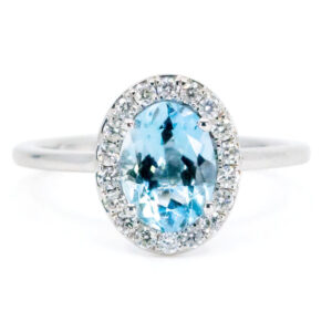 Oval Aquamarine And Diamond Cluster 18ct White Gold Ring