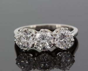 Platinum diamond three stone ring, round cut diamonds, 3 carats
