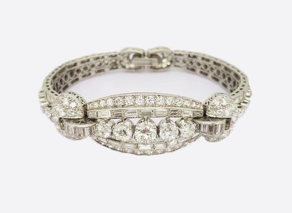 Vintage Diamond and Platinum Panel Bracelet; five graduated round-cut diamonds surrounded by baguette and circular-cut diamonds, 16.50 carat total
