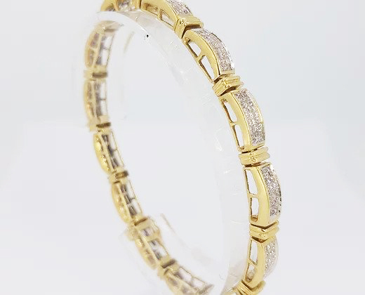 6.00ct Diamond and 18ct Yellow Gold Panel Line Bracelet; An elegant diamond bracelet comprising of diamond set panels, 18ct gold. Diamond total 6 carats