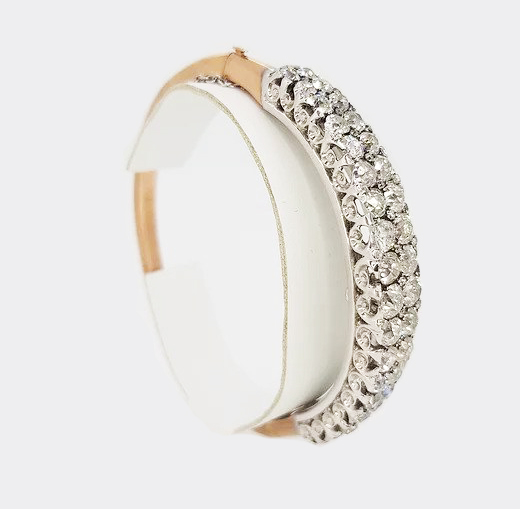 Early 20th Century 11.00ct Old Cut Diamond Bangle; Converts to a hair piece (mini Tiara) with fitting included, 11.00 carats, mounted in18ct white gold.