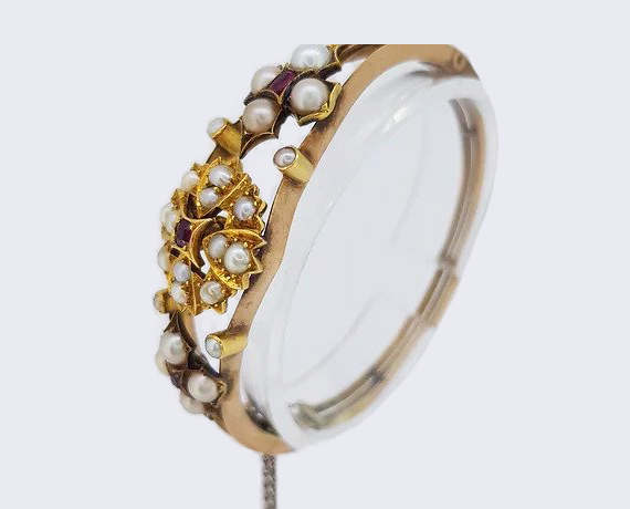 Antique Edwardian Pearl and Ruby Bangle, in 15ct yellow gold.