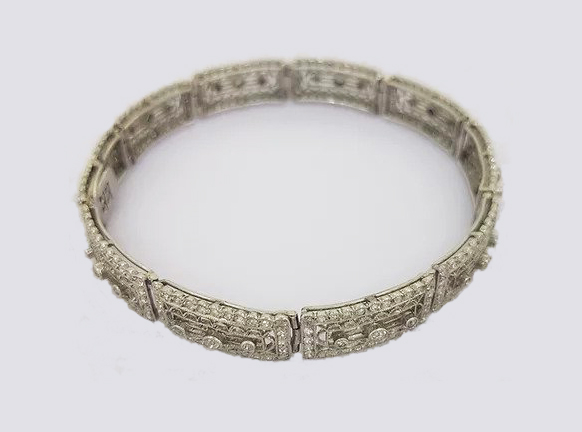 Art Deco Diamond and Platinum Filigree Panel Bracelet; Art Deco diamond filigree panel bracelet set with brilliant cut diamonds. Tests as platinum.