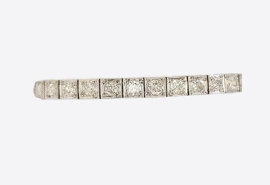 Art Deco Diamond and Platinum Line Bracelet; square collet-set diamond line bracelet crafted in platinum. Total diamond weight: 5.00 carats (estimated)