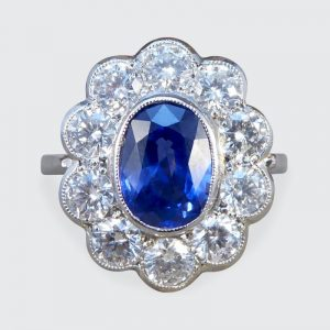 Oval Sapphire 1.70ct and Brilliant Cut Diamond Cluster Ring