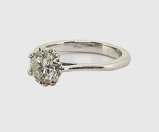Diamond Solitaire Engagement Ring; A traditional diamond engagement ring, 0.85cts, claw-set, in 18ct white gold.