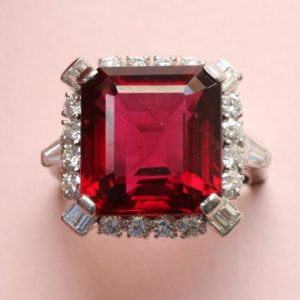 Bailey, Banks and Biddle Vintage Rubelite, Diamond and Platinum Square Ring; 12 carat step-cut rubelite bordered with mixed-cut diamonds, Signed, Circa 1950