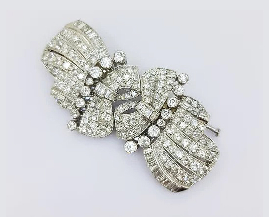 Vintage Diamond Double Clip Bow Brooch; set with baguette and brilliant-cut diamonds, in 18ct white gold. Total diamond weight: approximately 10.00 carats.