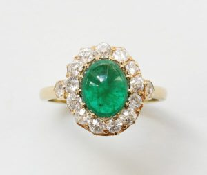 Antique Edwardian Oval Cabochon Emerald and Diamond Cluster Ring